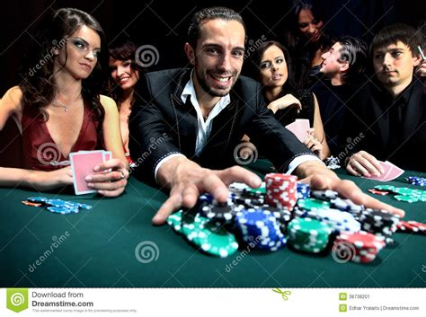 Poker Player Going All In Pushing His Chips Stock Image